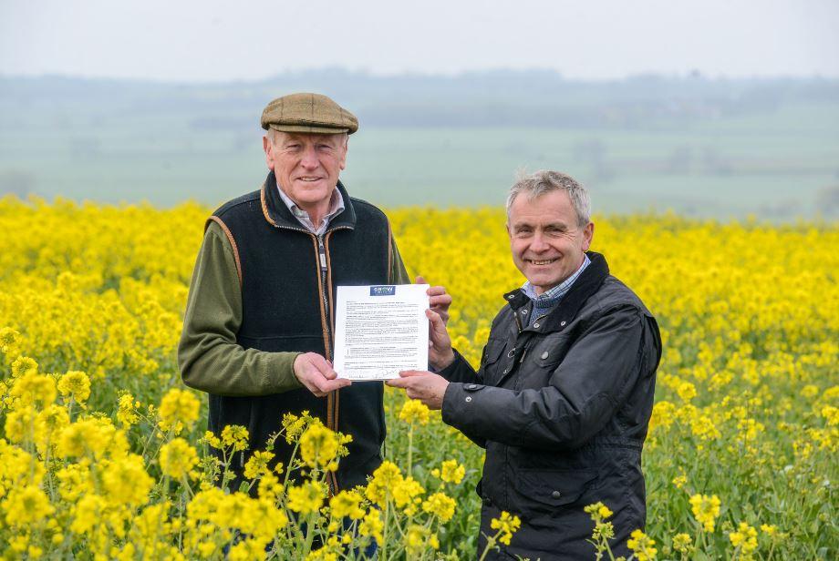 David Kerfoot handing over letter to Farming Minister, Robert Goodwill
